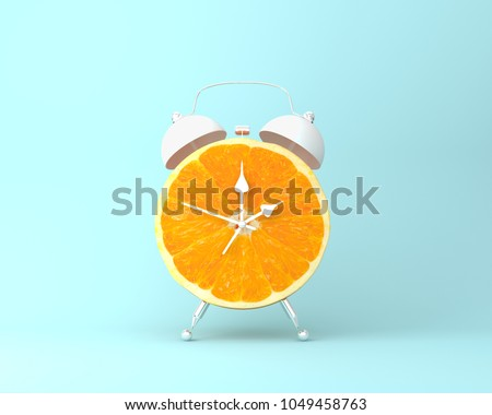 Creative idea layout fresh orange slice alarm clock on pastel blue background. minimal idea business concept. fruit idea creative to produce work within an advertising marketing communications