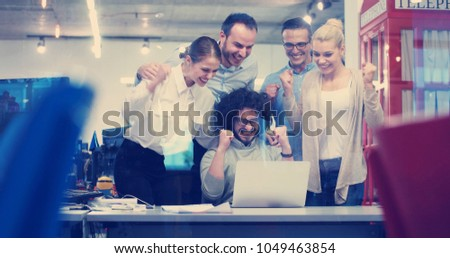Group of a young business people discussing business plan at modern startup office building #1049463854