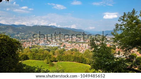 Bergamo, Italy - August 18, 2017: Panoramic view of the city of Bergamo from the castle walls. #1049485652