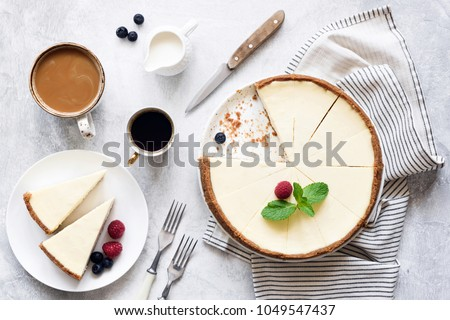 Classic New York Cheesecake And Coffee on White Concrete Background, Top View. Coffee and Cheesecake #1049547437