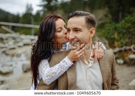 Beautiful couple walking among rocks #1049605670