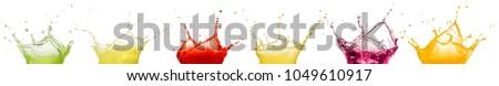 fruit juice splashes isolated on white background #1049610917