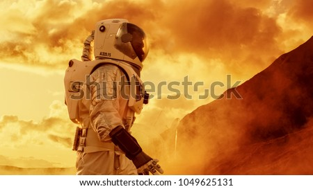 Proud Astronaut Confidently Walks on Mars Surface. Red Planet Covered in Gas and rock,  Overcoming Difficulties, Important Moment for the Human Race. #1049625131