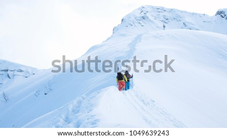 Skiers climb to the top of the mountain for freeride #1049639243