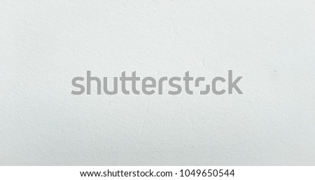 Grungy painted wall texture as background. Cracked concrete vintage wall background, old white painted wall. Background washed painting #1049650544