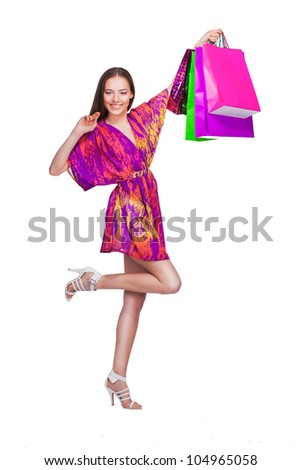 lovely woman with shopping bags over white #104965058