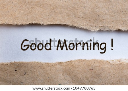 Piece of paper with text Good morning in torn envelope