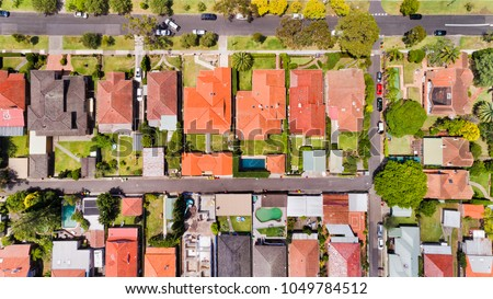Fine geometry of modern local living suburb of Chatswood in Sydney's North Shore in aerial overhead view over house roofs, back yards, pools and parked cars on the streets. #1049784512