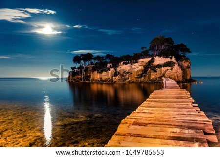 Fantastic night view of the Cameo Island. Great spring scene on the Port Sostis, Zakynthos island, Greece, Europe. Beauty of nature concept background. #1049785553