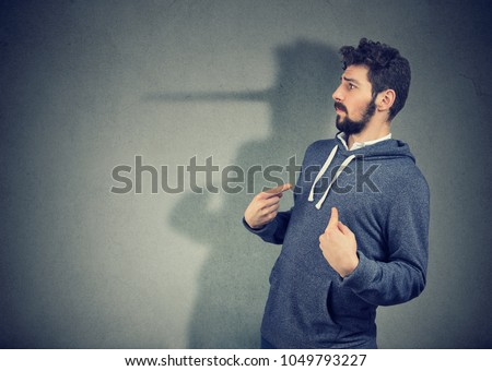 Side view of elegant man looking surprised when being caught on lie.  Royalty-Free Stock Photo #1049793227