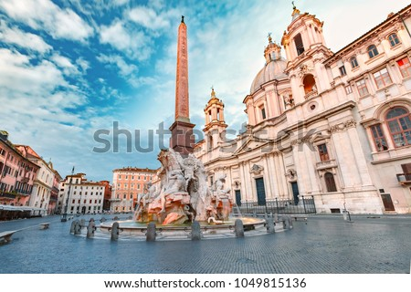 Fountain of the Four Rivers with an Egyptian obelisk and Sant Agnese Church on the famous Piazza Navona Square in the morning, Rome, Italy. #1049815136