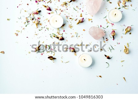 dried floral roses candles with rose quartz crystals on white background #1049816303
