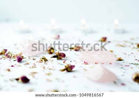 dried floral roses candles with rose quartz crystals on white background #1049816567