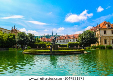 Castle panorama with pond fountain in Prague, Czech Republic, green grass on cloudy blue sky. Vacation, travelling, adventure, wanderlust concept. St. Vitus Cathedral in Prague, Czech Republic  #1049831873