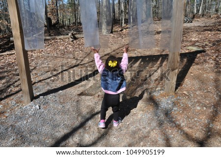 Little girl playing in an obstacle challenge on a horse obstacle course #1049905199
