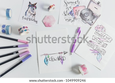 Hand lettering workspace artist on white background. paint, palette, watercolor, brushes, paper. Top view lettering. hand lettering quotes.  #1049909246