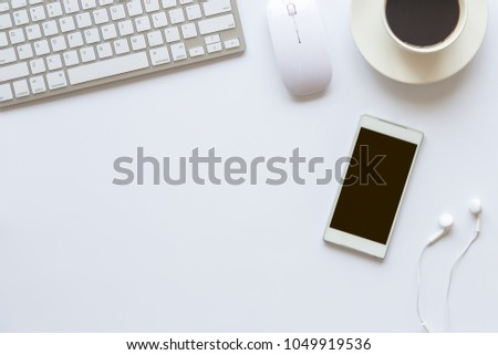 White desk office with laptop, smartphone and other work supplies with cup of coffee. Top view with copy space for input the text. Designer workspace on desk table essential elements on flat lay.  #1049919536