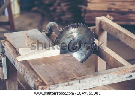 Background image of woodworking workshop: carpenters work table with different tools and wood cutting stand, vintage filter image #1049955083