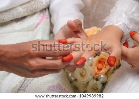 ring on bride's finger #1049989982