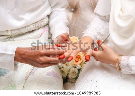 ring on bride's finger #1049989985