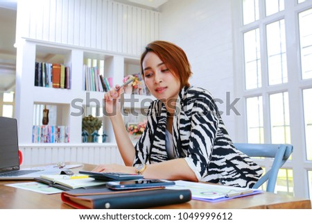 Business woman working in office with documents #1049999612