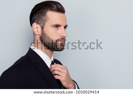 Half-faced portrait of stylish trendy handsome stunning attractive serious concentrated smart clever intelligent with modern haircut hairdo isolated on gray background copy-space Royalty-Free Stock Photo #1050029414