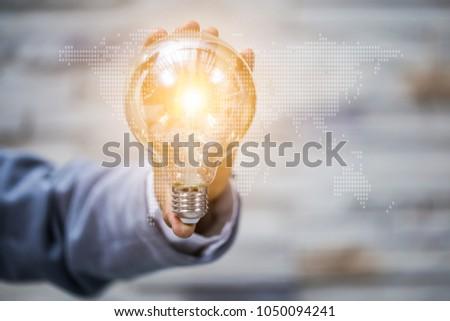 Business man holding light bulbs, ideas of new ideas with innovative technology and creativity. #1050094241