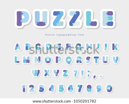 Puzzle paper cut out font in blue colors.  Vector #1050201782