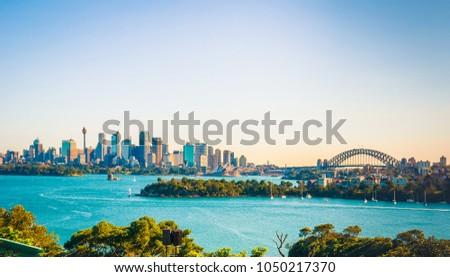 The city skyline of Sydney, Australia. Circular Quay and Opera House. #1050217370