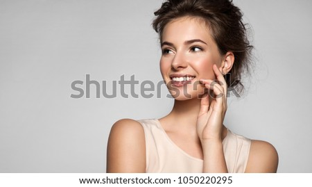 Portrait of young woman with perfect skin beautiful smile and natural make up #1050220295