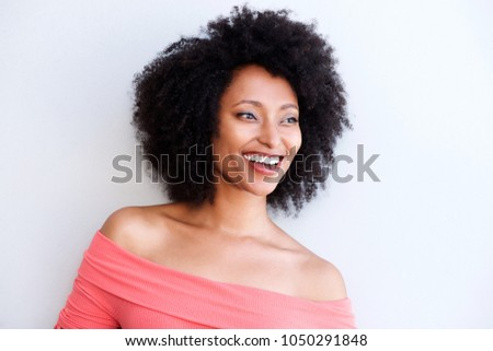 Close up portrait of beautiful smiling african woman against white background #1050291848