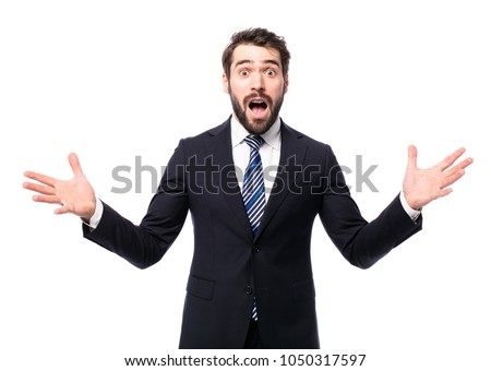business man wearing elegant suit lookimg shocked, confused using both of hands  isolated on white  #1050317597