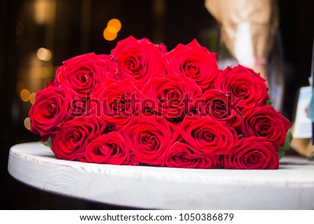 bouquet with many elegance fresh red roses on the table #1050386879
