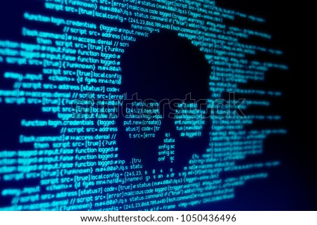 Computer code on a screen with a skull representing a computer virus / malware attack. #1050436496