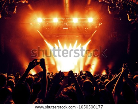 Concert hall lights with fans clapping #1050500177