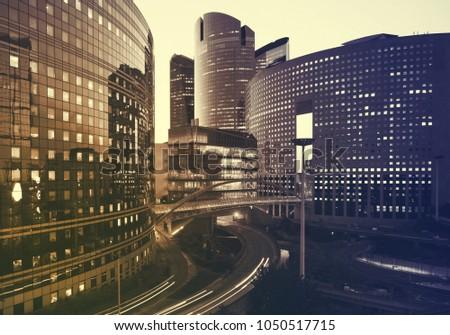 Office buildings in Paris business district La Defense. Sskyscrapers glass facades. Modern urban architecture, economy, finances, business activity concept. #1050517715