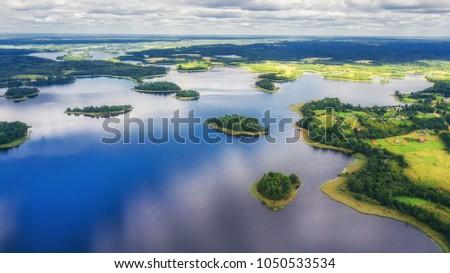 Lake with the bird's flight #1050533534