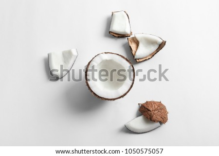 Ripe coconut on white background, top view #1050575057