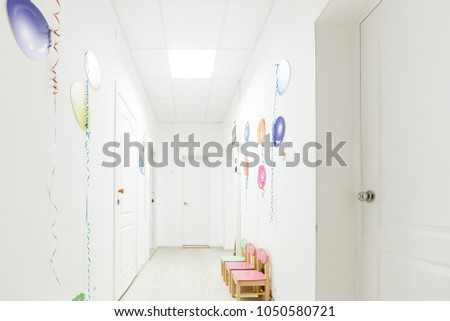 Bright interior of corridor hallway of a nursery school during the holidays without children #1050580721