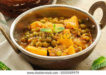 Homemade Aloo Mutter / Alu Matar  / Indian Peas potato curry served with Masala Puri #1050589979