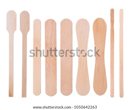 Wooden ice-cream sticks isolated on white background Royalty-Free Stock Photo #1050642263