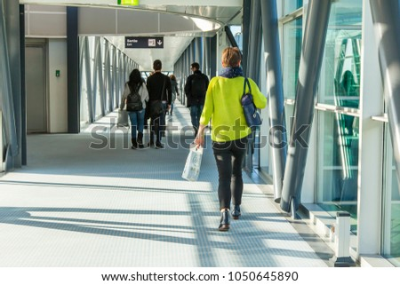 MARSEILLE, FRANCE, on March 2, 2018. Passengers go on the glazed gallery from the airplane to the passenger terminal of the airport #1050645890
