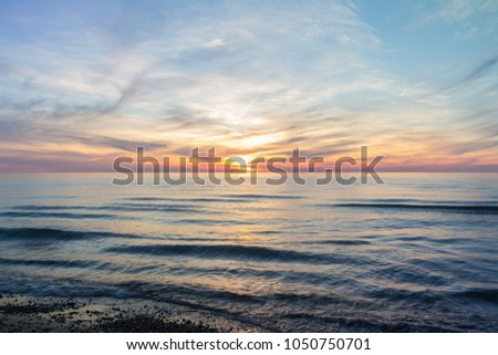 Photos from Lake Michigan at sunset.  Various angles, shutter speeds and processing techniques for a variety of looks. #1050750701