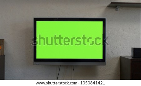 Modern television with chroma key green screen. A modern LCD TV with a green screen #1050841421