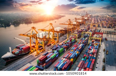Logistics and transportation of Container Cargo ship and Cargo plane with working crane bridge in shipyard at sunrise, logistic import export and transport industry background #1050901814