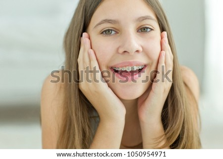 Girl with braces #1050954971