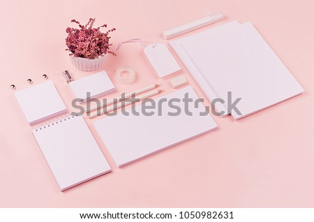 White branding stationery, mock up scene on light soft pastel pink background, blank objects for placing your design, inclined.