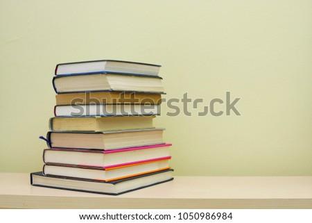 Stack of books on shelf #1050986984