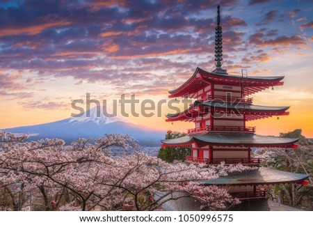 Mount Fujisan beautiful landscapes on sunset. Fujiyoshida, Japan at Chureito Pagoda and Mt. Fuji in the spring with cherry blossoms.  #1050996575