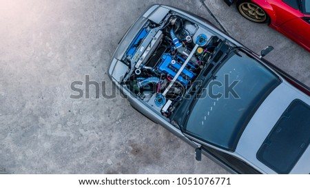 Top view super car engine open up. #1051076771
